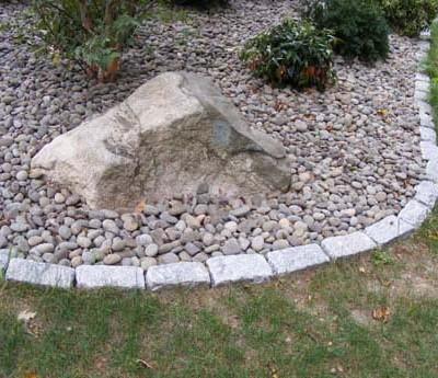 Cobblestone plant bed edging